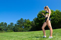 Fit woman listening to music during a workout Royalty Free Stock Photo