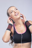 Fit Woman Listenining to the Music Stock Photos