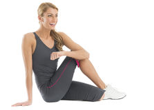 Fit Woman Looking Away While Doing Stretching Exercise Stock Photography