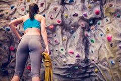 Fit woman looking up at rock climbing wall Royalty Free Stock Photos