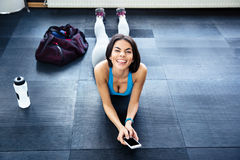 Fit woman lying on the floor and showing her tongue Royalty Free Stock Photos