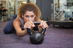 Fit woman lying with kettlebell Stock Photography