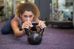 Fit woman lying with kettlebell Royalty Free Stock Image
