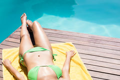 Fit woman lying on towel Royalty Free Stock Image
