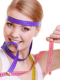 Fit woman with measure tapes. diet slimming. Stock Photography