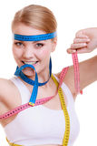 Fit woman with measure tapes. diet slimming. Royalty Free Stock Images