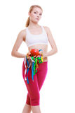 Fit woman with measure tapes fruit. diet slimming. Royalty Free Stock Photography