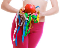 Fit woman with measure tapes fruit. diet slimming. Royalty Free Stock Images