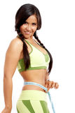 Fit woman measuring her tummy Stock Images