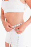Fit woman measuring her waist Royalty Free Stock Images