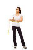 Fit woman measuring her waist royalty free stock photos