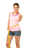 Fit Woman Measuring Waist While Gesturing Thumbs Up Stock Images