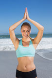 Fit woman meditating on the beach Royalty Free Stock Photography