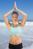 Fit woman meditating on the beach Royalty Free Stock Photos