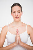 Fit woman meditating with hands crossed Royalty Free Stock Photography