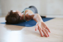 Fit woman in a meditative yoga pose at gym Stock Photo