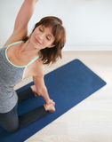 Fit woman in a meditative yoga pose at gym Royalty Free Stock Photography