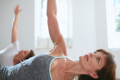 Fit woman in a meditative yoga pose at gym Royalty Free Stock Image