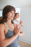 Fit woman in a meditative yoga pose at gym Royalty Free Stock Images
