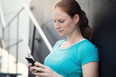 Fit Woman with Mobile Phone stock image