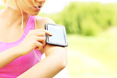 Fit woman with phone Royalty Free Stock Photo