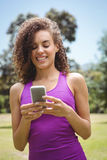 Fit woman on the phone in park Stock Photography
