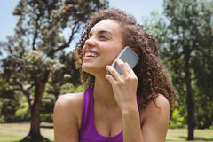 Fit woman on the phone in park Royalty Free Stock Images