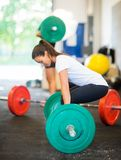 Fit Woman Picking Barbell At Healthclub Stock Images