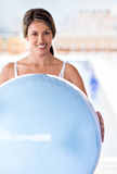 Fit woman with a Pilates ball Stock Images