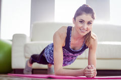 Fit woman planking on exercise mat Stock Image