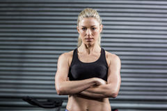 Fit woman posing with crossed arms Royalty Free Stock Photo