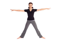 Fit Woman Practicing Yoga Exercice. Young fit woman doing yoga exercise called Warrior (Sanskrit name: Virabhadrasana), isolated on white background Royalty Free Stock Images