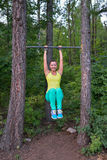 Fit woman preparing to do pull ups on horizontal bar Royalty Free Stock Image