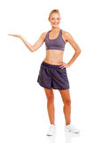 Fit woman presenting Stock Image