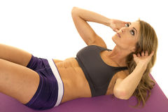 Fit woman in purple shorts crunch look up Royalty Free Stock Images