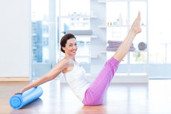 Fit woman raising her legs Stock Photography