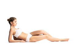 A fit woman relaxing in white sporty lingerie Stock Photography
