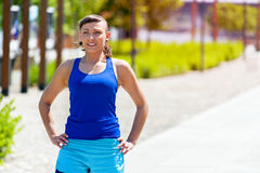 Fit woman resting after jogging. Stock Photos