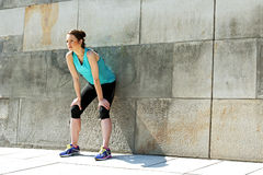 Fit woman resting after run in the city. Jogger. Stock Photo