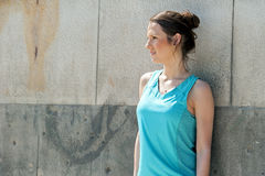 Fit woman resting after run in the city. Jogger. Royalty Free Stock Photography