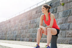 Fit woman resting after run. Stock Image