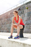 Fit woman resting after run by the river. Stock Photos