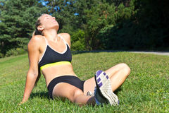 Fit woman resting in the sun after a workout Stock Photo
