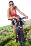 Fit woman riding mountain bike Stock Photo