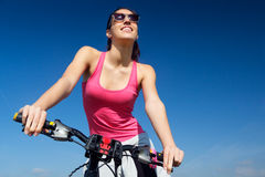 Fit woman riding mountain bike stock images