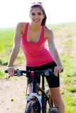 Fit woman riding mountain bike Stock Photography