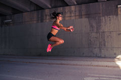 Fit woman runner warming up outdoors Stock Image