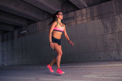 Fit woman runner warming up outdoors Royalty Free Stock Photos