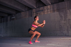 Fit woman runner warming up outdoors Royalty Free Stock Photography