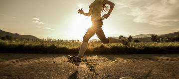 Fit woman running fast Royalty Free Stock Image